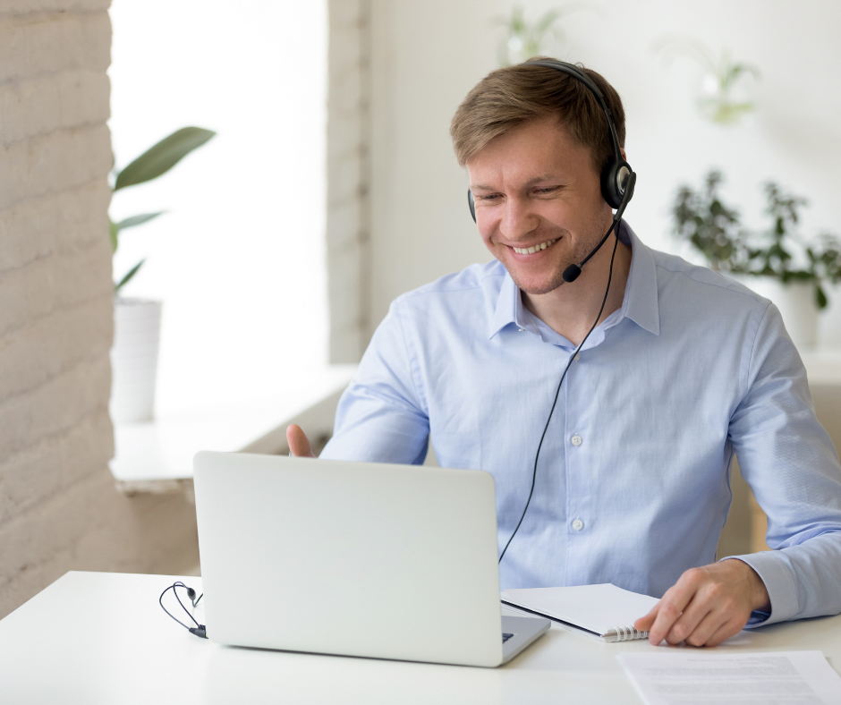 man using laptop for video conferencing